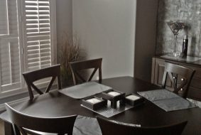 Vinyl shutters in a dining room