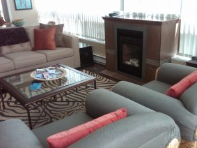 Fireplace, blinds, new fabric for the upholstery on the chairs and sofa, as well as new wall to wall carpeting.